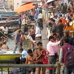 varanasi ghats (gerben more) Tags: varanasi ghat people chaos umbrella benares ritual ganges ganga india