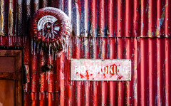 Fire and Ice (jtr27) Tags: dscf3405xl4 jtr27 fuji fujifilm fujinon xe2s xf 35mm f2 f20 rwr wr corrugated metal building red fire alarm bell ice icicles maine newengland