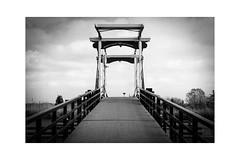 River Rotte 2 (Hans de Meij) Tags: rotte drawbridge landscape sky water blackandwhite monochrome analog 135 nikonfm2n zoomnikkor2885mm13545 kodakc200 reflectaproscan10t bwconversion explore