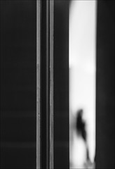 F_MG_8176-1-BW-Canon 6D2-Tamron 28-300mm-May Lee 廖藹淳 (May-margy) Tags: maymargy bw 黑白 人像 逆光 剪影 模糊 散景 門框 柱子 白牆 街拍 線條造型與光影 天馬行空鏡頭的異想世界 心象意象與影像 幾何構圖 點景 點人 台灣攝影師 台北市 台灣 中華民國 fmg81761bw portrait backlighting silhouette blur bokeh doorframe column white wall streetviewphotography linesformsandlightandshadow mylensandmyimagination naturalcoincidencethrumylens taiwanphotographer canon6d2 tamron28300mm maylee廖藹淳 humaningeometry humanelement taipeicity taiwan repofchina