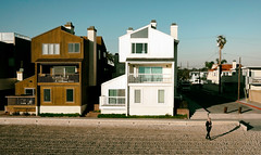 """in CA"" (helmet13) Tags: leicaxvario sealbeach california usa woman building summerhouse beach sand wheeltracks sunshine afternoon silence silhouette shadow aoi peaceaward world100f"