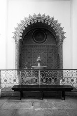 Church of Santa Maria (stephgallant) Tags: portugal algarve faro iberianpenninsula europe southerneurope blackandwhite monochrome highcontrast architecture design church canon60d canon sigma1020mm sigma sigma1020 wideangle saintmaria igreja santamaria fountain basin inset ornate arab moor moorish interior bw