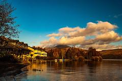 Lodge On Loch Lomond (Brian Travelling) Tags: scotland pentax pentaxdal pentaxk20d lochlomond lodge trees freshwater blue sky clouds fluffyclouds autumn