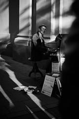 The pianist (iamunclefester) Tags: münchen munich street autumnstreetphotos autumn blackandwhite monochrome imaginarium pianist piano outside church heiliggeistkirche pfarrkircheheiliggeist heiliggeist sunny sun shadows people crowd gathering melody music ralphkiefer