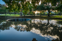Down the drain (tquist24) Tags: hdr highlandpark lakesidepark nikon nikond5300 outdoor texas turtlecreek creek geotagged grass lawn reflection reflections river spillway trees water dallas oaklawn clouds