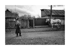 Woman and horse (Paphylo) Tags: countryside leicaq ukraine europe street people reallife chernigov horse rural village countrylife document