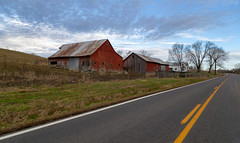 Brittingham Farm — Sprigg Township, Adams County, Ohio (Pythaglio) Tags: brittingham farm agriculture ohio unitedstates us buildings structures historic barns barn bentonville adamscounty spriggtownship verticalboard red painted metal roof sky clouds