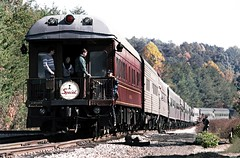Norfolk Southern operated N&W A class 2-6+6-4 articulated steam locomotive # 1218 Fall leaf colors Railfan Excursion train that is powered by three diesel engines at this time with the observation car shown while it heads to Crossville, Tennessee, 10-1987 (alcomike43) Tags: norfolksouthern norfolkwestern crossvilletennessee harrimanjunction railfanexcursiontrains railroads trains passengertrains observers passengers railfans photographers onlookers scenic countryside trees forest fallleafcolors mountains tracks rails ties ballast roadbed rightofway branchline mainline switch turnout jointedsectionrail passengercars coach observationcar heavyweightpassengercars lightweightpassengercars diesels emd aclass articulated 2664 steamengine steamlocomotive coalburning photo photograph slide color historic vintage old classic