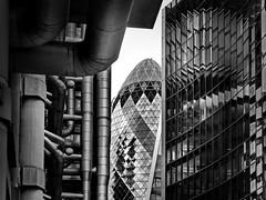 the gherkin between ... (heinzkren) Tags: london gb uk building gebäude architektur architecture lines blackandwhite bw sw monochrome panasonic lumix urban windows reflection city skyscraper contemporary modern lloyds tubes pipes röhren innamoramento