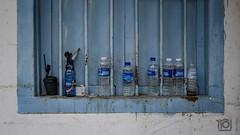 Still (water) life - Singapore (Paul Perton) Tags: fuji singapore x100f blue bottles candid city street streetphotography urban water windowsill