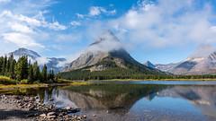 Swiftcurrent Lake ((JAndersen)) Tags: glacier glaciernationalpark montana mountains fog clouds swiftcurrentlake mountgrinnell grinnell manyglacier reflection water usa landscape nikon d810