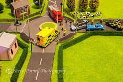 Emergency Response 1 (Steve Purnell Photography) Tags: accident police fire ambulance littlepeople fields trees buildings cows hedges abstract policeservice firebrigade ambulanceservice policemen firemen paramedics policevehicle fireengine people cars rta roadtrafficaccident roundabout roads fences grass