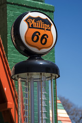 Phillips 66 (DJ Wolfman) Tags: oklahoma gasstation phillips66 blue red green gaspump olympus omd em1markii zuiko 12100mmf4zuiko zd sky
