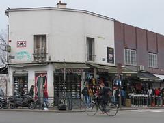 Space Invader PA_1382 (tofz4u) Tags: 93 seinesaintdenis banlieue grandparis paris streetart artderue invader spaceinvader spaceinvaders mosaïque mosaic tile pa1382 black noir blanc white rouge red street rue people boutique shop vélo velo bike bicycle bicyclette