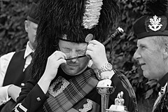 Tight fit. (Robertinsco) Tags: pipemajor pipeband scotland candidphotography candidstreetphotography candid candidportrait candidblackwhite blackwhite blackandwhite blackwhitephoto blackwhiteportrait gx8 lumixgvario45150f4056