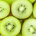 Juicy ripe slices of kiwi background