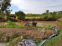 Rice paddies in Phon Phisai 4 (SierraSunrise) Tags: agriculture esarn farming grain isaan nongkhai paddyrice phonphisai pumps rice ricepaddies ricepaddy thailand