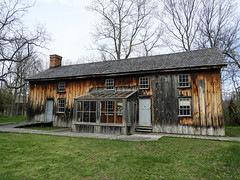 Day 3, front of the DeLaurier house, Pt Pelee (annkelliott) Tags: ontario canada ptpelee pointpelee delaurierhomesteadtrail homestead building old architecture house home oncewashome weathered stained pattern wood tree grass boardwalk outdoor spring 9may2018 nikon b700 nikonb700 annkelliott anneelliott ©anneelliott2018 ©allrightsreserved