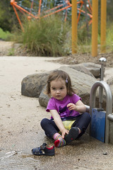 sitting in a puddle (louisa_catlover) Tags: portrait family child park playground outdoor playgroup friends tabby tabitha daughter toddler