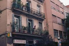 i'm just a natural at it (jesuiselouise) Tags: 35mm kodak analog minoltasrt100x barcelona spain street candid city urban summer man old building