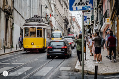 Famous retro yellow tram on the street in Lisbon city, Portugal (Jorge B. Garrido) Tags: rail historic street city locomotive panorama cityscape transportationsystem tourist architecture public summer tramway attraction symbol lisboa landmark transportation traffic outdoors railway antique yellow lisbon downtown view electric retro traditional cablecar car trolley old european scenic historical vintage tram vehicle town portugal iberia famous commuter urban cable building travel portuguese train history streetcar scene road tourism europe transport