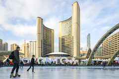 Skating @ City Hall during the Fair in the Square (A Great Capture) Tags: agreatcapture agc wwwagreatcapturecom adjm ash2276 ashleylduffus ald mobilejay jamesmitchell toronto on ontario canada canadian photographer northamerica fall autumn automne herbst 2018 torontoexplore nathanphillipssquare cityhall ice rink skate activity winter movement torontosign newcityhall fairinthesquare 6dmarkii canon2470mm28 xoto colours colors colourful colorful cityscape urbanscape eos digital dslr lens canon 6d mark ii 2470mm people