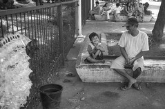 Father and Son (Beegee49) Tags: street man father son laughing happy selling fish blackandwhite monochrome bw sony planet silay city philippines asia