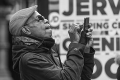 Carefully does it (Frank Fullard) Tags: frankfullard fullard candid street portrait photographer careful serious mobile finger error concentration dublin ireland irish tourist visitor monochrome black white blanc noir