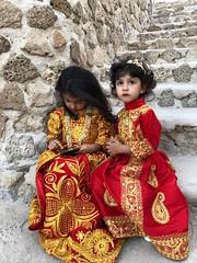 Bahrain (Manama) Beautiful girls with national dress (ustung) Tags: portrait cellphone nationaldress dress girl fort bahreyn bahrain