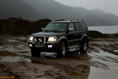 Cruising in the Rain (Infernal elf) Tags: land cruiser toyota rain mud led bf goodrich foggy angle muddy water sea fjord hills green trees pines powerful lifted city araco j100 1hdfte 42 l turbodiesel i6 offroad big family suv lc90 2001 50th anniversary reflections silver dark