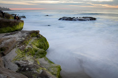 Moss on Rocks (Photos By Clark) Tags: california cities subjects beachshots location canon2470 unitedstates northamerica sandiego canon5div locale places where pacific longexposure lightroom nik colorefx water waves rocks photographer people moss green sunset yellow orange flow tide thesandiegoist