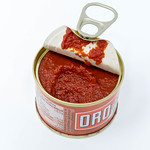 Oro tomato paste in an opened small can on white background thumbnail