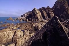 Lee Bay (Christian Hacker) Tags: lee leebay broadoarbay northdevon coastline coast rugged rocky rocks cliffs geology landscape sea water ocean sunlit may seascape canoneos50d tamron1750mm outdoors outandabout rockstriata rocklayers spiky