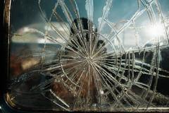 Shattered (MilkaWay) Tags: georgia hallcounty simpsonfarm cargraveyard junkyard junkcars classiccars oldcars glass shatteredglass brokenglass reflections carwindow