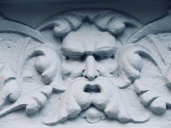 Green Man Gargoyle on Building Facade 4773 (Brechtbug) Tags: green man gargoyle building facade 25th street between 7th 8th avenues nyc 11122018 new york city midtown manhattan 2018 gargoyles portraits monster portrait monsters creature faces spooky art architecture sculpture keystone mask brownstone brown stone