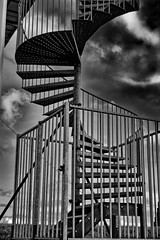 Stepping Out (Alfred Grupstra) Tags: architecture builtstructure blackandwhite railing staircase outdoors nopeople sky steel buildingexterior metal urbanscene cloudsky constructionindustry architectureandbuildings steps bridgemanmadestructure modern spiralstaircase