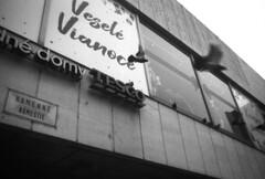 Merry Christmas (Peter Lukáč) Tags: bratislava pressburg kamennenamestie prior odprior tesco matusik ivanmatusik architecture architectureofbratislava architectureofslovakia socialistarchitecture streetsofslovakia slovakia slovensko christmas merrychristmas pigeon birds ilford