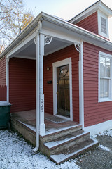 Porch — Lexington, Kentucky (Pythaglio) Tags: lexington kentucky unitedstates us fayettecounty house dwelling residence historic onestory balloonframe woodsiding 22windows porch spandrels posts steps trim painted red snow