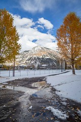 Crested Butte, Colorado, USA (Geraldine Curtis) Tags: snow gunnison colorado usa skiresort crestedbutte october fallcolours yellow gold firtrees mountain reflection