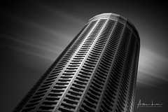 It's Not The Tower Of Pisa (Alec Lux) Tags: bw singapore architecture art asia black blackandwhite blackandwhitephotography building buildings centre city clouds design exterior facade fine fineart geometric geometry hotel lines longexposure longexposurephotography matrix minimal minimalism modern orient oriental outdoor outside sky skyscraper stack stacked stamford structure swissotel trails urban white