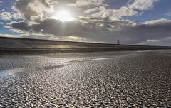 Leasowe beach and sea defence (Philip Brookes) Tags: sun sea coast tide sand beach shore water light crepuscular rays sunshine cloud weather wind lighthouse wirral leasowe uk england northwest britain winter evening afternoon sunset wallasey merseyside seadefence