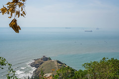 Islet and Sea Viewpoint from a Mountain in Vung Tau, Vietnam (wuestenigel) Tags: view leaves waves beach vungtau ships travel viewpoint bay islet vietnam tree vacation coast holiday sea water wasser strand seashore reise meer landscape landschaft sky himmel ocean ozean noperson keineperson nature natur island insel baum outdoors drausen summer sommer rock daylight tageslicht urlaub seascape seelandschaft bucht sand