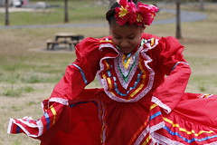 Jennifer Mejia, 10, dances in Robinson Park in Greensboro. Mejia is very close to her grandmother Abila and loves dancing with her friends.