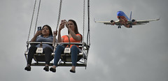 Up In The Air (Scott 97006) Tags: amusement ride ladies girls jet plane sky