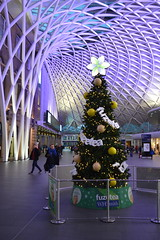 King's Star (dhcomet) Tags: kings cross station christmas tree star concourse whsmith ad advert sponsorship fuzetea