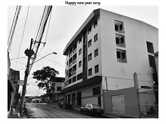 Happy New Year! (Guilherme Alex) Tags: city cityscape citylife cityview walking around plaza square street buildings perfect angle life living dv100 samsung digitalcamera amateur art lights nightfall unique beautiful concrete windows tree wheels teófilootoni minasgerais brazil frame picture busy lines perspective composition world outside exploring mycity mylife myworld lovedit happy urban urbanization deadcolors black white cityday citystreet tower trucks movement cold cloudyday fast biggest rainyday rain wet light best neighborhood out contrasts solid blackandwhite lovelycity