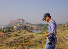 An Asian man standing on the hill (phuong.sg@gmail.com) Tags: adult adventure asian backpack beauty casual city cityscape clothing curiosity day destinations direction enjoyment exploration explorer freedom hiking hill india journey looking male man men mountain outdoors people photographer photography rajasthan searching standing summer sunlight temple tourism tourist travel vacations young