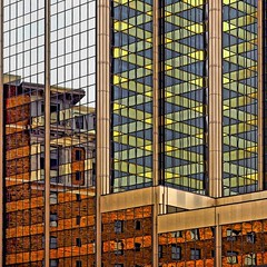 Stripey Reflections (2n2907) Tags: abstract reflection glass office building windows skyscraper green yellow orange stripe olympus omd mirrorless