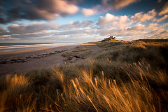 Bamburgh Winter Light England (ANG Imagery) Tags: moving cloudscape grassy castle coast northumberland wintersun coastal seascape bamburgh landscape
