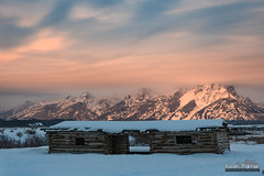 Sunrise at Cunningham Cabin (kevin-palmer) Tags: december winter cold snow snowy nikond750 tamron2470mmf28 moran grandtetonnationalpark tetons mountains cunninghamcabin old historic structure logcabin building morning sunrise dawn cloudy overcast color colorful orange